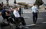 Disabled, handicapped and activists block the entrance to Jerusalem as they attend a protest calling for better health care, September 18, 2017. (Yonatan Sindel/Flash90)
