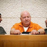 Zvi Gur (c), who is serving a life sentence for the murder of Oron Yarden, in the Supreme Court on July 6, 2009. (Miriam Alster/Flash90)