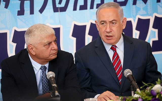 Prime Minister Benjamin Netanyahu (right) next to Ma'ale Adumim Mayor Benny Kashriel during a meeting of the Likud party in the West Bank town, October 3, 2017. (Hadas Parush/Flash90)