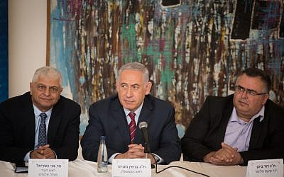 Prime Minister Benjamin Netanyahu (center) with mayor of Ma'ale Adumim Benny Kashriel (right) during a Likud faction meeting in Ma'ale Adumim, near Jerusalem on October 3, 2017. (Hadas Parush/Flash90)