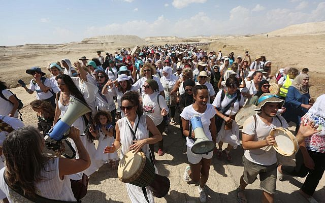 Women from the 'Women Wage Peace' movement and Palestinians take part in a march near the Jordan River, in the West Bank on October 8, 2017. (Flash90)