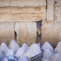 Jewish men perform the annual priestly blessing during the Sukkot holiday at the Western Wall in the Old City of Jerusalem on October 8, 2017. (Yonatan Sindel/Flash90)