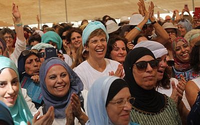 Women from the 'Women Wage Peace' movement and Palestinians take part in a march near the Jordan River, in the West Bank on Oct 8, 2017. (Flash90)