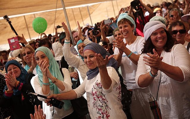 Women from the 'Women Wage Peace' movement take part in a peace march near the Jordan River on Oct 8, 2017. (Flash90)