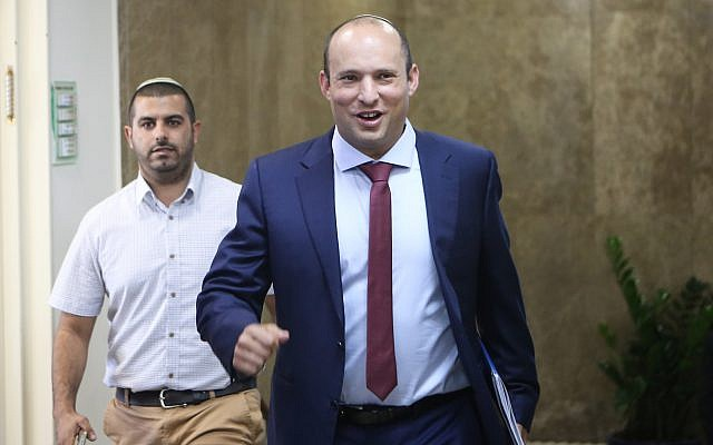 Education Minister Naftali Bennett arrives at the weekly government conference at the PM's office in Jerusalem on October 15, 2017. (Alex Kolomoisky/POOL)