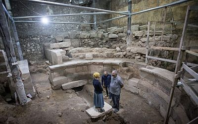 Israel Antiquities Authority archaeologists (left to right) Tehillah Lieberman, Dr. Joe Uziel and Dr. Avi Solomon at the site of an ancient Roman theater-like structure, hidden for 1,700 years adjacent to the Western Wall underneath Jerusalem's Old City, on October 16, 2017 (Yonatan Sindel/Flash90)
