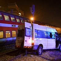The scene where a van was hit by a passenger train in Lod on October 17, 2017. (Avi Dishi/Flash90)