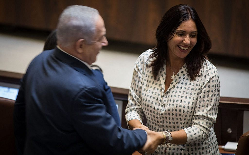 Prime Minister Benjamin Netanyahu and Culture Minister Miri Regev shake hands during the opening of the winter session of the Knesset on October 23, 2017. (Hadas Parush/Flash90)