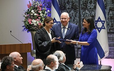 President Reuven Rivlin and Justice Minister Ayelet Shaked stand alongside incoming Supreme Court Chief Justice Esther Hayut  during her swearing in ceremony at the President's Residence in Jerusalem on October 26, 2017. (Miriam Alster/Flash90)