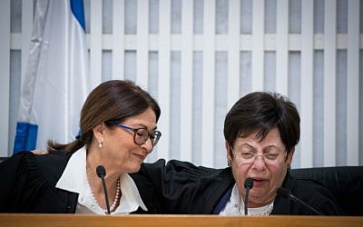 Outgoing president of the Supreme Court Judge Miriam Naor with incoming Supreme Court president Esther Hayut during a ceremony in honor of Naor's retirement in Jerusalem on October 26, 2017. (Yonatan Sindel/Flash90)
