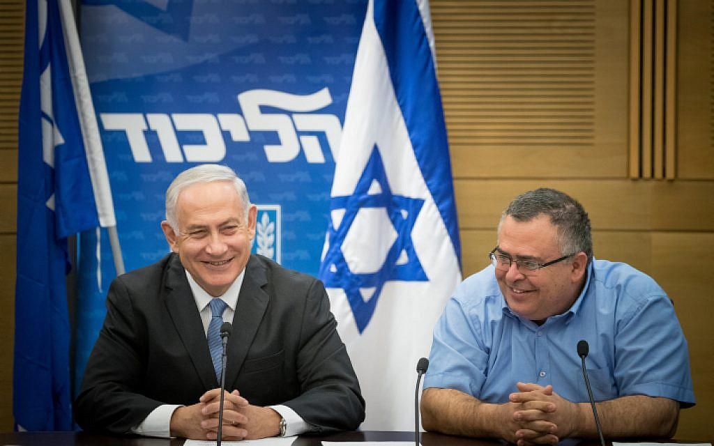 Prime Minister Benjamin Netanyahu, left, with coalition chairman MK David Bitan, right, during a Likud party faction meeting at the Knesset, October 30, 2017. (Yonatan Sindel/Flash90)