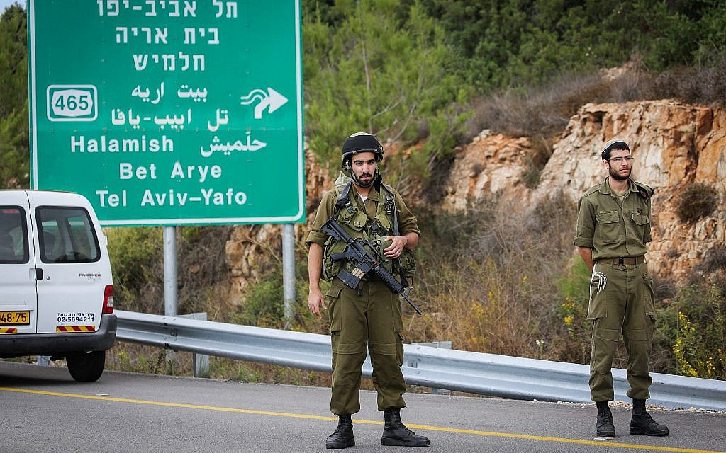 Illustrative: Security forces are seen near the West Bank settlement of Halamish, where IDF soldiers shot dead a Palestinian driver who they said accelerated toward them, on October 31, 2017. (Flash90)