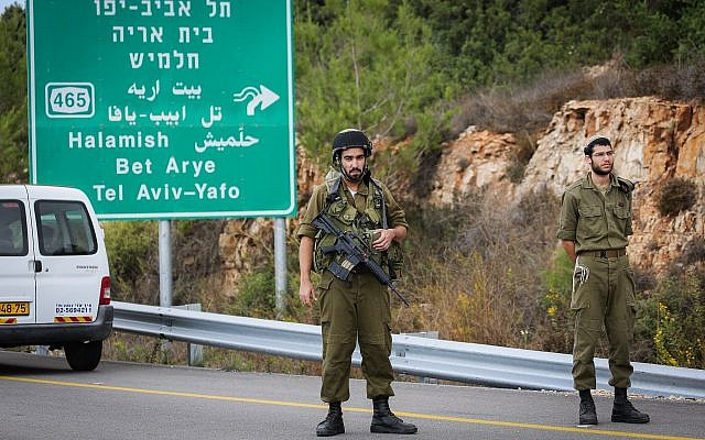 Security forces are seen near the West Bank settlement of Halamish, where IDF soldiers shot dead a Palestinian driver who they said accelerated toward them, on October 31, 2017. (Flash90)