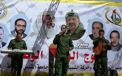 A banner praising Palestinian terrorists as 'heroes' is seen at an Al-Quds University reception for new students on October 15, 2017. (Palestinian Media Watch)
