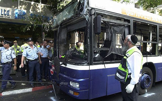 Illustrative: Israeli police and aid workers search the scene of a suicide bomb attack in a bus on September 19, 2002 in Tel Aviv. (Rahanan Cohen/Israel Defense Forces/Getty Images via JTA/File)