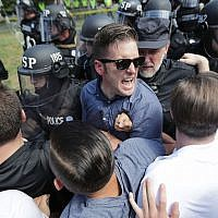 "White supremacist leader Richard Spencer, center, and supporters clashing with police after the ""Unite the Right"" rally in Charlottesville, Virginia., was declared unlawful, August 12, 2017. (Chip Somodevilla/Getty Images)"