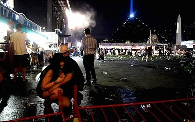Concertgoers taking cover at a country music festival on the Las Vegas Strip following a mass shooting attack, October 1, 2017. (David Becker/Getty Images)