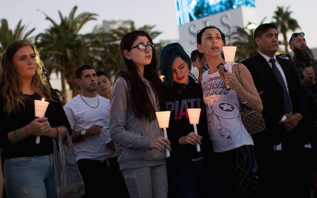 Mourners attending a candlelight vigil in Las Vegas for the victims of the mass shooting there, Oct. 2, 2017. (Drew Angerer/Getty Images, via JTA)