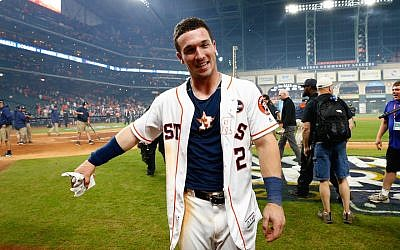Alex Bregman #2 of the Houston Astros celebrates after hitting the game-winning single during the tenth inning to defeat the Los Angeles Dodgers in game five of the 2017 World Series at Minute Maid Park on October 30, 2017 in Houston, Texas. (Jamie Squire/Getty Images via JTA)