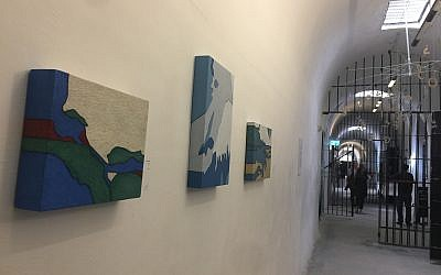 This year's Jerusalem Biennale challenged artists to seek watershed moments in their own history, and in that of the Jewish people; these are some of the works hung in the Underground Prisoners Museum, one of the eight locations of the art exhibitions (Jessica Steinberg/Times of Israel)