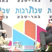 Labor chairman Avi Gabbay (right) is interviewed at a cultural event in Beersheba on October 14, 2017. (Screen capture/YouTube)