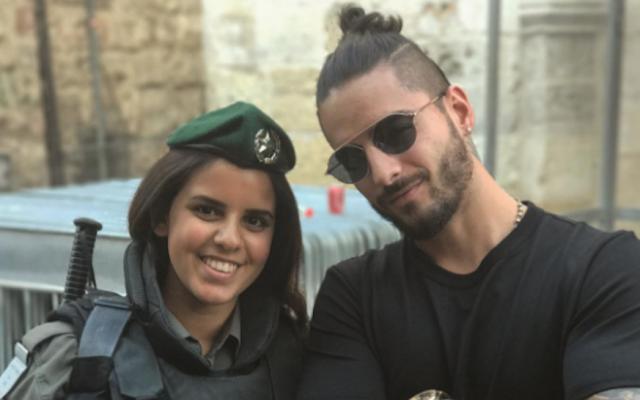 Maluma, right, posing with an Israeli police officer. (Instagram via JTA)