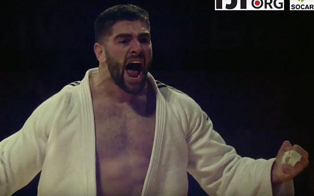 Israeli judoka Peter Paltchik celebrates after winning a bronze medal at the Abu Dhabi Grand Slam judo tournament in Abu Dhabi, United Arab Emirates, on October 28, 2017. (Screen capture: YouTube)