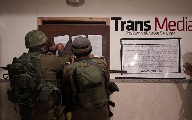 IDF soldiers during a raid at the offices of the Trans Media broadcast company in the West Bank, October 17, 2017. (IDF)