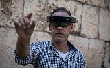 A man takes a look through Augmented Reality glasses at the Innovation Lab event at the Tower of David Museum in Jerusalem's Old City, October 17, 2017. (Hadas Parush/Flash90)