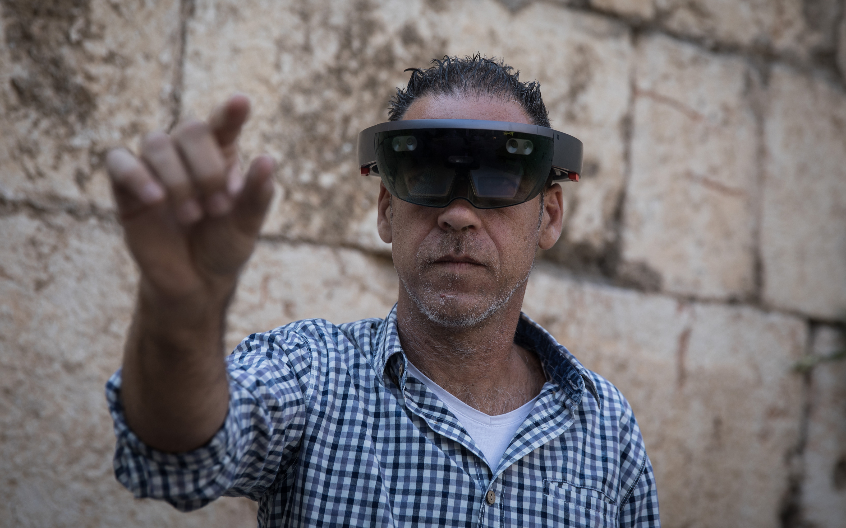 98a1496dce86 A man takes a look through Augmented Reality glasses at the Innovation Lab  event at the