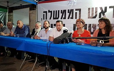 Members of the Jewish Home party sit at a protest tent with Samaria Regional Council chairman Yossi Dagan (3rd from R) outside the Prime Minister's Residence in Jerusalem on October 25, 2017. (Courtesy: Samaria Regional Council)
