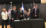 Texas Governor Greg Abbott signing his state's anti-BDS bill at a Jewish community center in Austin, May 2, 2017. (Office of the Texas Governor)