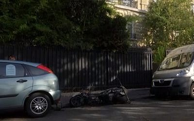 The remains of a motorbike which caught fire and exploded outside the office of the Jordanian military attache in Paris, France, October 4, 2017. (Screen capture)