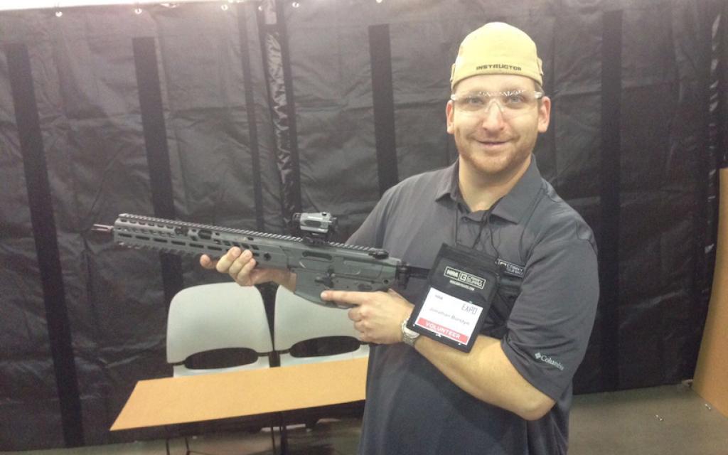 Jonathan Burstyn, a Jewish gun instructor, at an NRA convention, August 2017. (Courtesy of Burstyn via JTA)