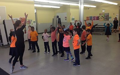 First graders learn Israeli dance at Hebrew Language Academy, a Brooklyn charter school that teaches Hebrew and Israeli culture, but not Judaism. (Ben Sales via JTA)