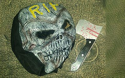 Scary mask and plastic ax confiscated by police from a youth in Jerusalem, October 6, 2017. (Israel Police)
