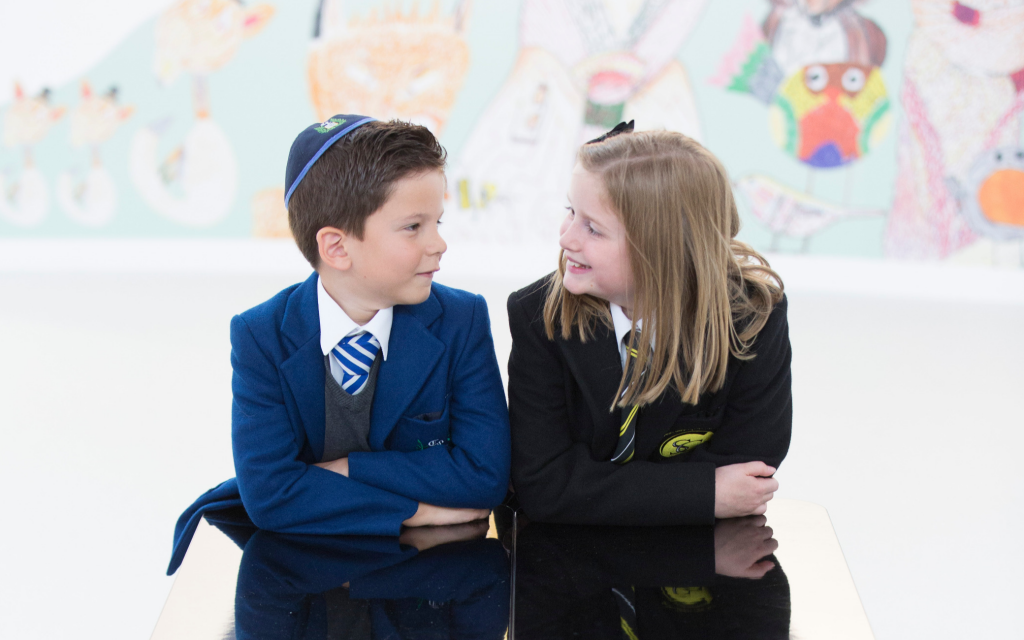 Students from the Jewish Calderwood Lodge school and St. Clare's Catholic Primary. Both schools share one building. (Courtesy)