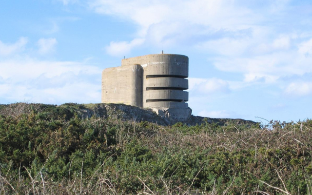 German WWII bunker 'The Odeon' in Alderney. The bunker is about three to four stories high and has an anti-aircraft emplacement at the back. Alderney is said to have been the most heavily fortified of the Channel Islands. (CC-SA-Tim Brighton)