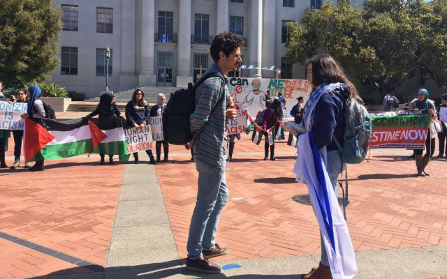 University of California Berkeley junior Adah Forer speaks to a student in front of a pro-Palestinian demonstration on campus. (Courtesy)