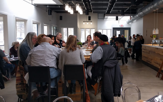Patrons eat at a communal table in the Soul Cafe in West Bloomfield, Michigan. (Yaakov Schwartz/Times of Israel)