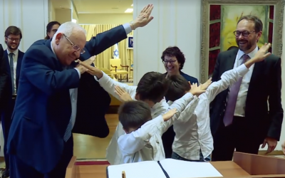 President Reuven Rivlin 'dabs' with the new EU Ambassador to Israel Emanuele Giaufret's sons at the President's Residence in Jerusalem on October 26, 2017. (Screen capture: Facebook)