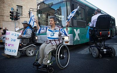 Disabled activists block a road in Jerusalem as part of their campaign for better benefits,  October 9, 2017. (Yonatan Sindel/Flash90)