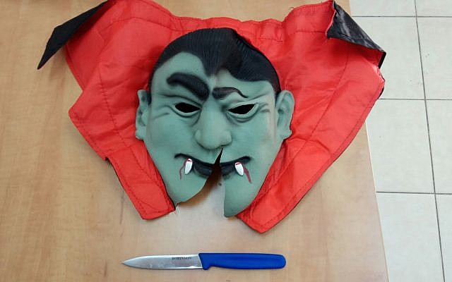 A Dracula mask and knife confiscated from a 13-year-old boy detained by police in the coastal city of Herzliya in a continuing crackdown on youngsters wearing masks to scare the public, October 4, 2017. (Police spokesperson's office)