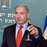 Prime Minister Benjamin Netanyahu toasts the upcoming Jewish New Year at the PM's office in Jerusalem on September 7, 2015.  (Haim Zach / GPO)