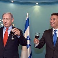 Yossi Cohen, right, head of the Mossad secret service, raises a toast together with Prime Minister Benjamin Netanyahu, ahead of the upcoming Jewish New Year at the PM's office in Jerusalem on September 7, 2015.  (Haim Zach / GPO)