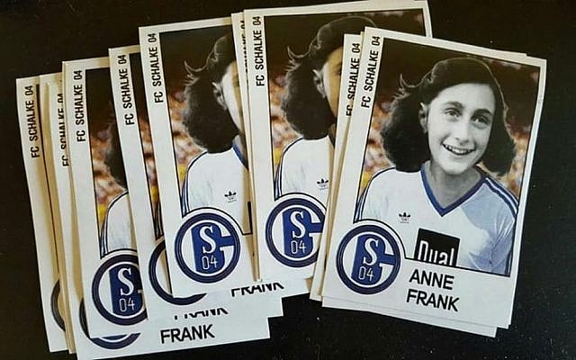 Stickers showing a doctored photo of Anne Frank wearing a German soccer team's jersey in Dusseldorf, Germany (Twitter)