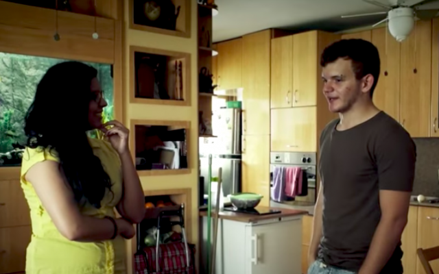 Kifah Dasuki, an Arab vegan activist, and Guy Podolovich, a YouTube star, meet and cook together in one of the chapters of 'Working On It,' created by filmmakers Tomer and Barak Heymann (Courtesy Heymann Brothers)