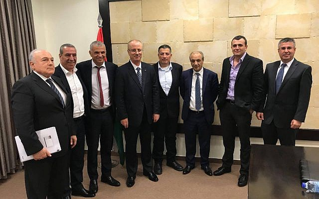 Illustrative: Finance Minister Moshe Kahlon (3rd from left) meets with Palestinian Authority Prime Minister Rami Hamdallah (4th from left) in Ramallah, on October 30, 2017. (Twitter)