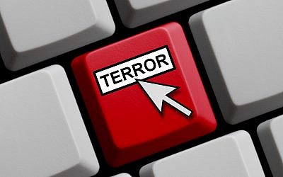 Illustrative image of computer keyboard with mouse arrow showing Terror online. (keport/iStock via Getty images)
