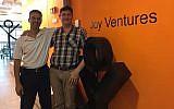 Avi Yaron, CEO of Joy Ventures, left, with chief operating officer Idan Katz at their offices in Herzliya in Sept. 2017 (Shoshanna Solomon/TimesofIsrael)